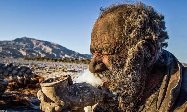 This 80 year old man who choose to live like an animal owns a steel pipe that he uses to smoke animal droppings!