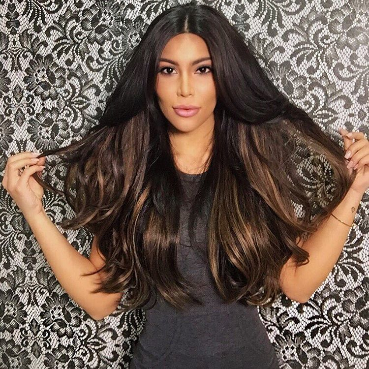 Osman looks like she could be the long lost sister or cousin of Kim.