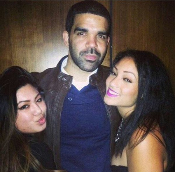 He looks like Drake, but these girls aren't posing with the real Drake.